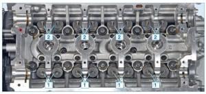 Головка блока цилиндров: 1 – впускные клапаны; 2 – выпускные клапаны